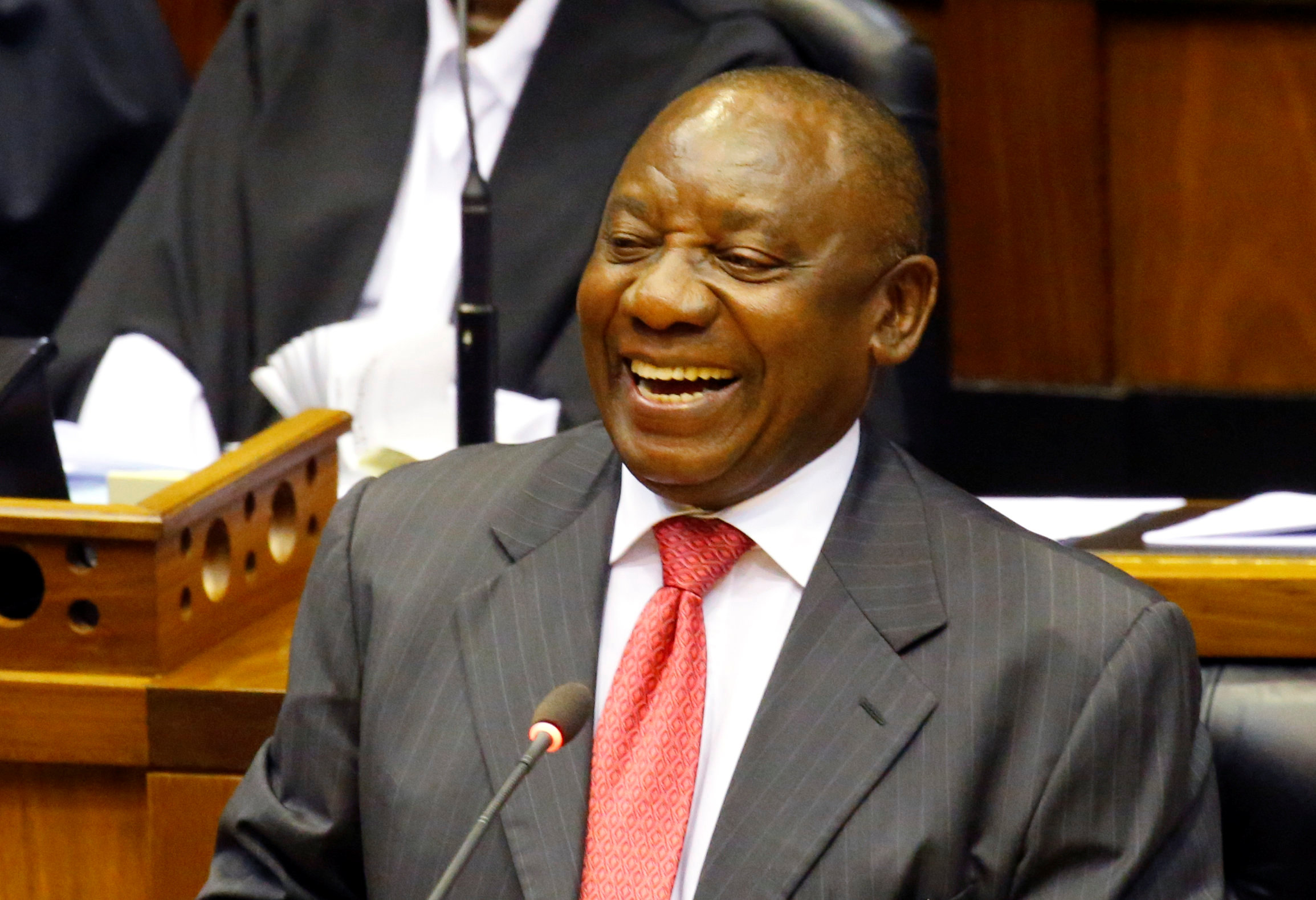 President of South Africa Cyril Ramaphosa smiles as he addresses MPs after being elected president in parliament in Cape Town, South Africa, February 15, 2018.