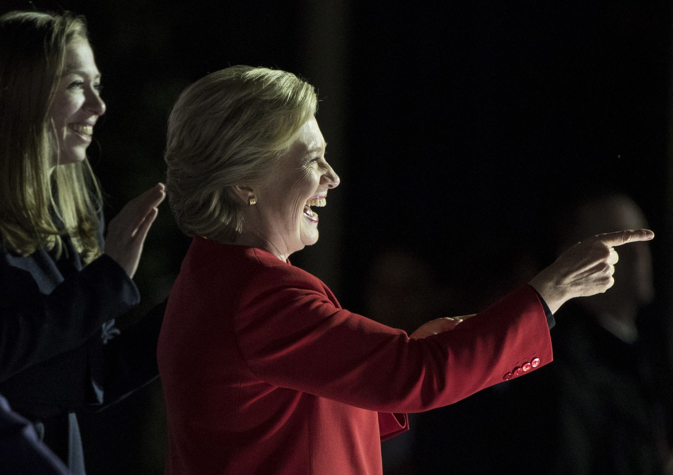 epaselect epa05621693 US Democratic presidential candidate Hillary Clinton (R) gestures to supporters as her daughter Chelsea Clinton looks on during a campaign rally on the day before election day on Independence Mall