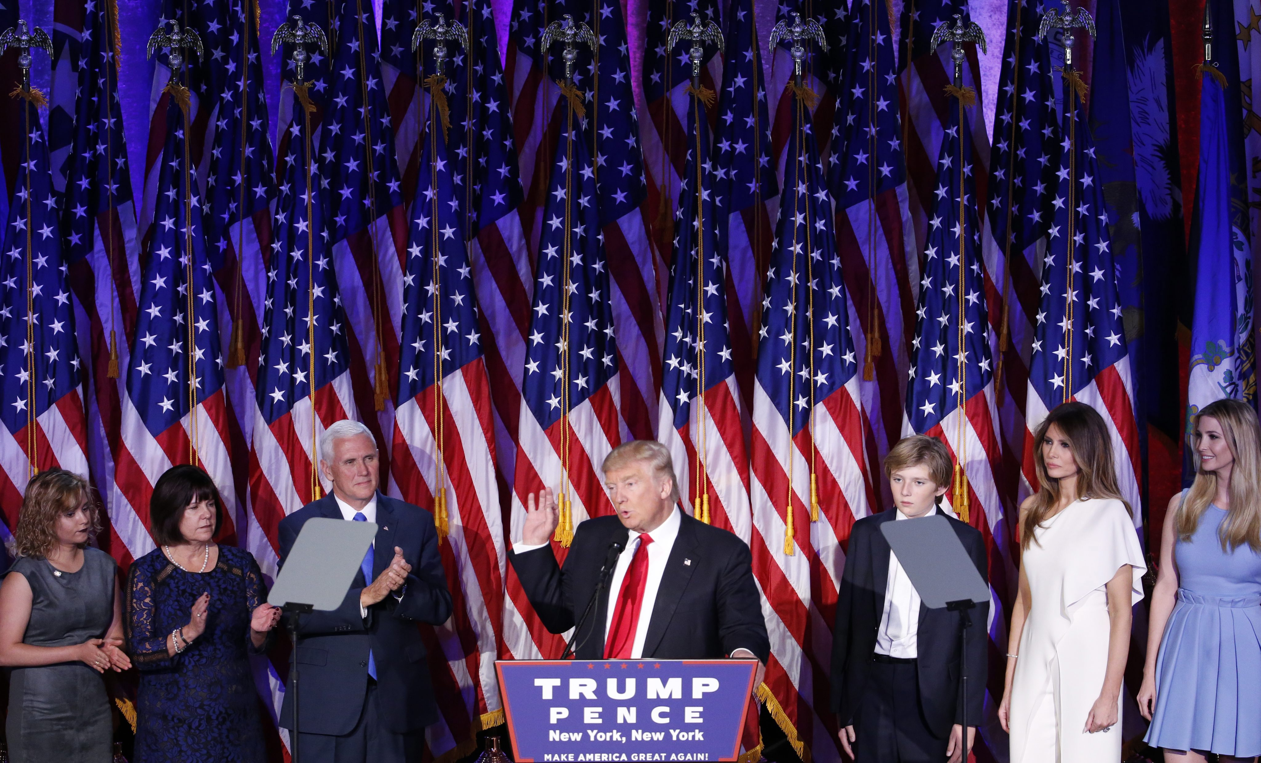 epa05623975 US President-elect Donald Trump (C) speaks on stage at his 2016 US presidential Election Night event, as votes continue to be counted at the New York Hilton Midtown in New York, New York, USA, 08 November 20
