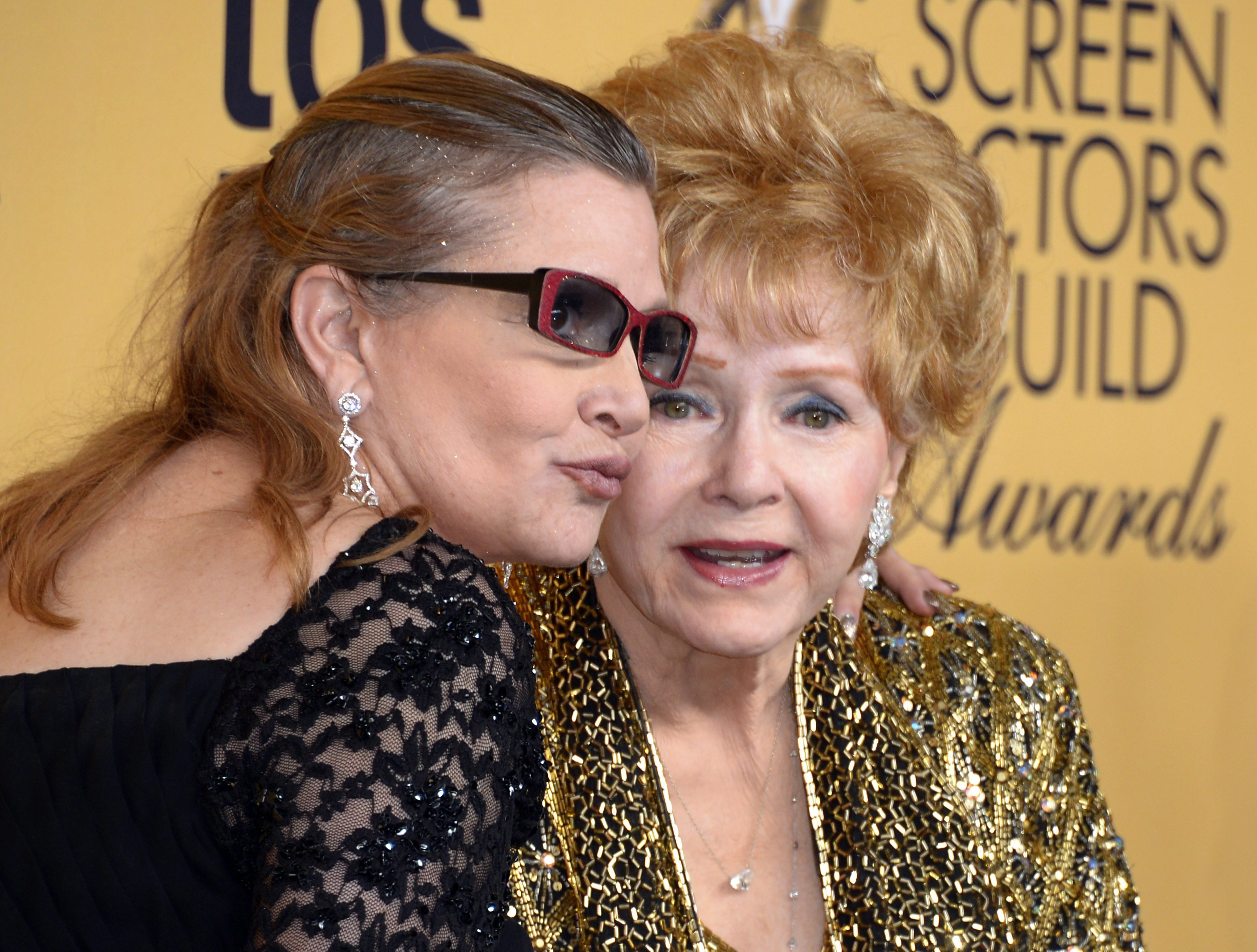 epa05690440 (FILE) - A file picture dated 25 January 2015 shows US actresses Debbie Reynolds (R) and her late daughter Carrie Fisher (L) posing at the 21th Annual Screen Actors Guild Awards ceremony at the Shrine Audito