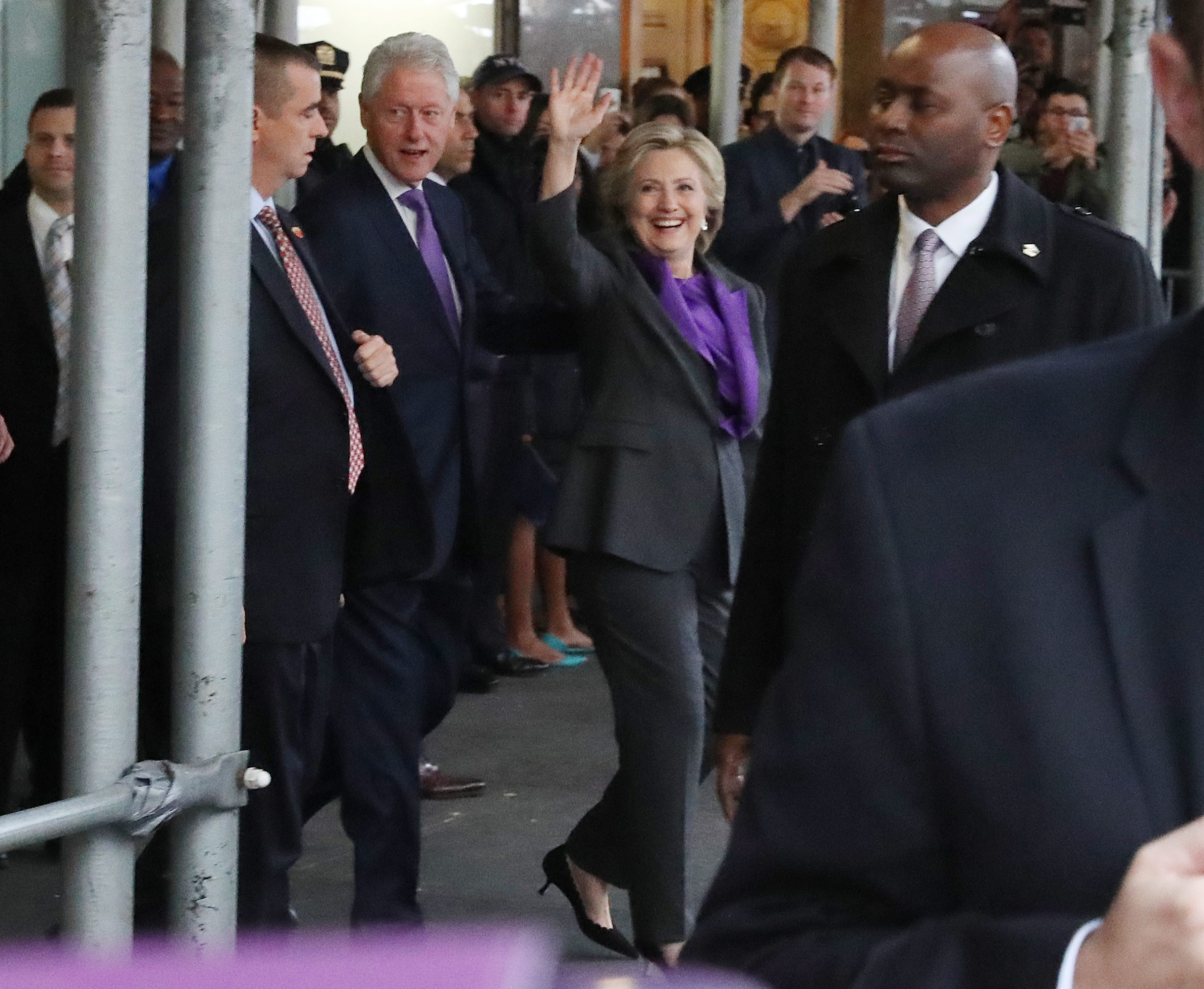 epa05624509 US Democratic Party presidential nominee Hillary Clinton (R) and former US President Bill Clinton (L) wave as they leave following a speech to supporters and staff after her defeat to Republican Party nomine